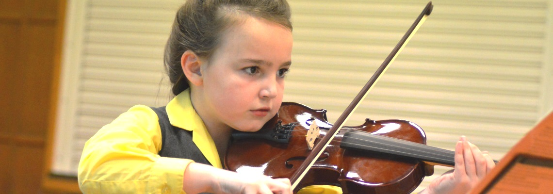 Pupil playing violin at Coopersale Hall