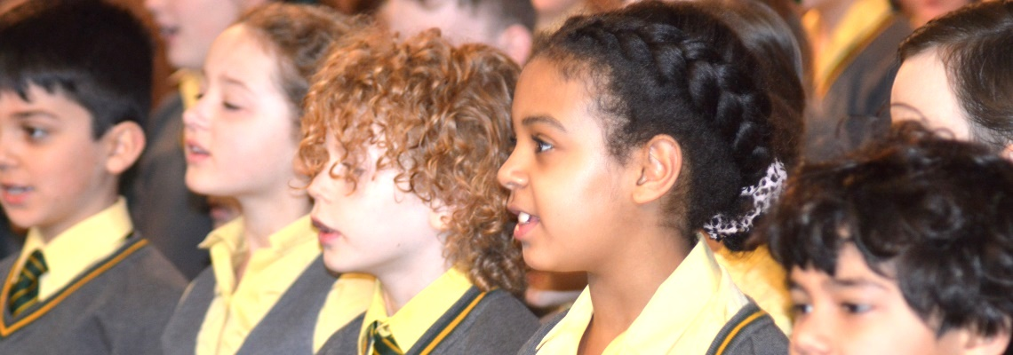 Pupils in assembly at Coopersale Hall